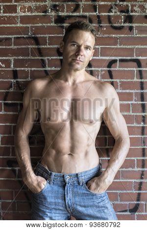 Urban Shirtless Man In Blue Jeans