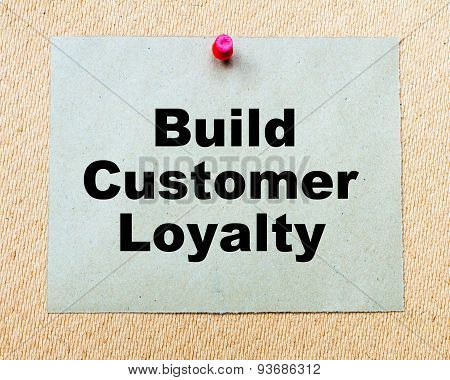 Build Customer Loyalty  Written On Paper Note