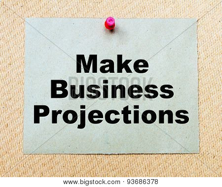Make Business Projections Written On Paper Note