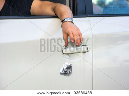 Man Tossing Litter from Open Car Window