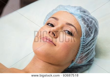 Beautician performs cosmetic procedures