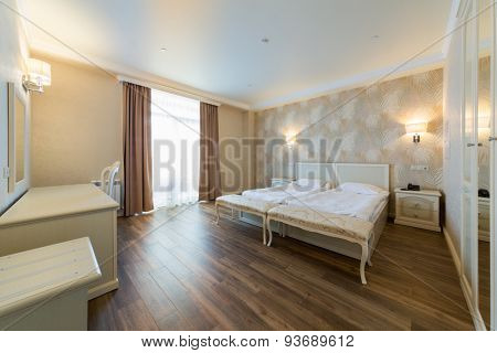 ADLER, RUSSIA - JULY 21, 2014: Interior of a hotel room with beds and table in El Paraiso hotel