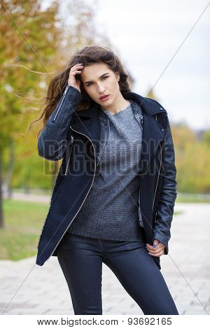 Beautiful young model walking in autumn park