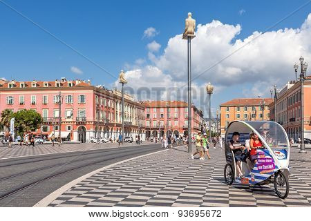 NICE, FRANCE - AUGUST 23, 2014: People on Place Massena - one of the main city squares, place for carnivals, concerts, parades, traditional celebrations and other public events.