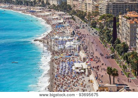 NICE, FRANCE - AUGUST 23, 2014: Beach and promenade of Nice - fifth most populous, second-largest on French Mediterranean coast and one of most visited cities with 4 million tourists every year.
