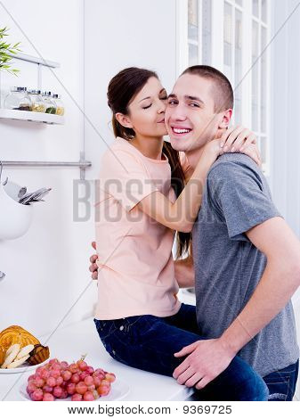 Happy Lovers In The Kitchen