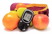picture of diabetes  - Glucose meter fresh fruits tape measure dumbbells and purple towel for using in fitness concept for diabetes lifestyle and healthy nutrition - JPG