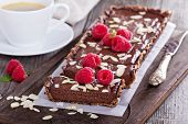 foto of tarts  - Vegan chocolate tart with almonds and a cup of coffee - JPG