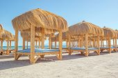 image of gazebo  - beach with thatched gazebo and sun loungers - JPG