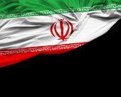 picture of tehran  - Iranian waving flag on black background - JPG