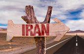 stock photo of tehran  - Iran wooden sign with desert road background - JPG