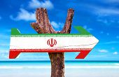 picture of indian flag  - Iran Flag wooden sign with a Indian Ocean on background - JPG