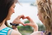 picture of  friends forever  - Heart shape made of hands from two best girl friends - JPG