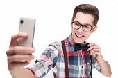 pic of nerds  - Young nerd in glasses and checkered shirt with smartphone making selfie isolated on white background - JPG