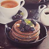 stock photo of buckwheat  - Blueberry pancakes with buckwheat flour for breakfast toned image - JPG