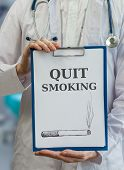 stock photo of quit  - Doctor is warning and giving advice to stop and quit smoking - JPG