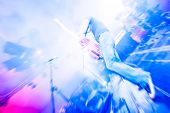 pic of guitarists  - motion blur abstract of a rock guitarist on stage - JPG