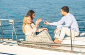image of mans-best-friend  - Young people having fun with smartphone on exclusive luxury sailing boat  - JPG