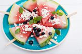 picture of popsicle  - Fresh watermelon popsicles with blueberries and cheese cut on ice - JPG