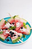 stock photo of popsicle  - Fresh watermelon popsicles with blueberries and cheese cut on ice - JPG