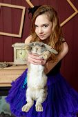 image of alice wonderland  - Young girl at the image of Alice in Wonderland - JPG