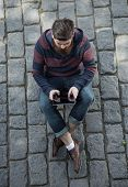 picture of moustache  - Handsome big moustache hipster man in the city with tablet - JPG
