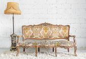 stock photo of couch  - Classical style Armchair sofa couch in vintage room with desk lamp - JPG