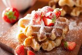 image of icing  - belgian waffles with icing sugar and strawberry - JPG