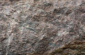 image of gneiss  - Gneiss rock wall closeup for background texture - JPG