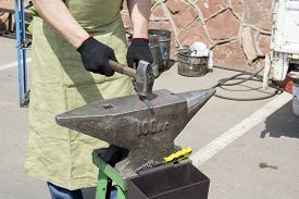 picture of anvil  - smith beats a hammer on iron preparation on an anvil not indoors - JPG