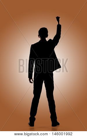 Silhouette of Asian businessman open arms feel free, rear view, full length portrait isolated
