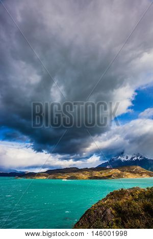 A giant cloud over the picturesque lake Pehoe. Torres del Paine National Park - Biosphere Reserve.  Chile, Patagonia