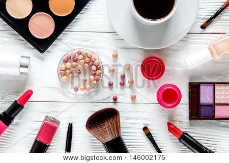 makeup set on white table with lavender, coffe cup top view