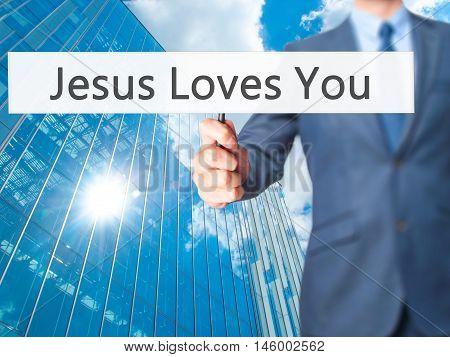 Jesus Loves You - Businessman Hand Holding Sign