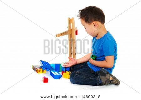 Chinese Boy Playing With Toys