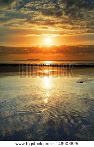reflections at beal beach near ballybunion on the wild atlantic way ireland with a beautiful yellow sunset