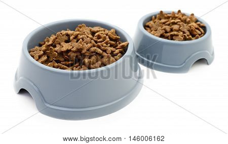 Two cat's plastic bowls on white background.