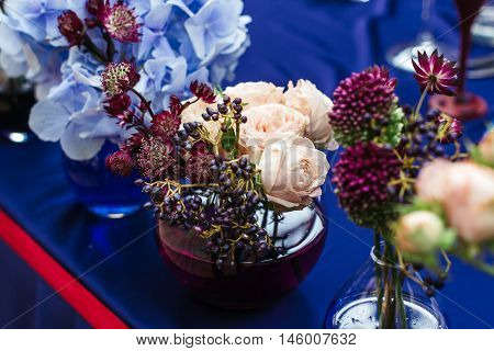 Beautiful decor at the wedding. Flowers standing on the table. Top-down plan