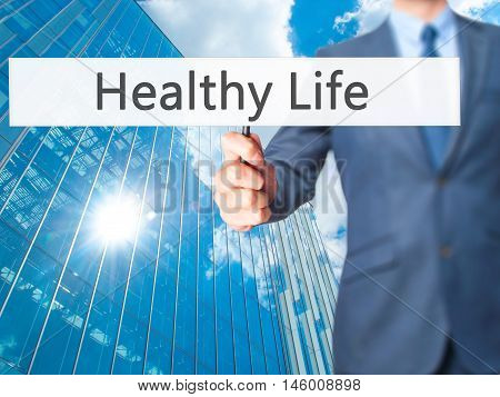 Healthy Life - Businessman Hand Holding Sign