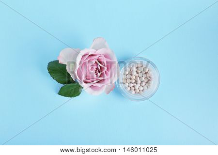 Blusher and flower on blue background