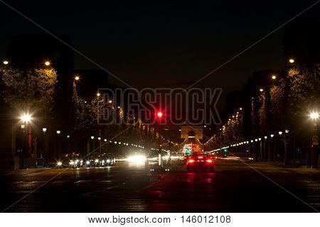 Famous Champs Elysee boulevard in Paris at night