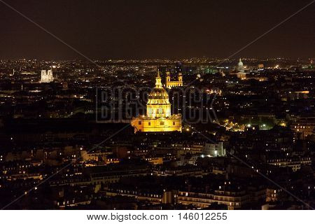 View from the Eiffel Tower at night. Les invalides building in the frame.