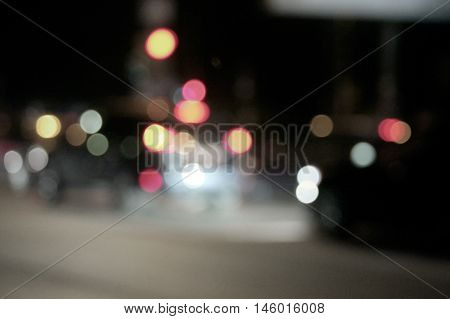 City night scene bokeh shot. Abstract night lights defocused nightlife image.