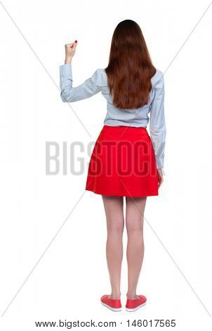 Back view of woman. Raised his fist up in victory sign Long-haired brunette in red skirt shows the gesture of victory.