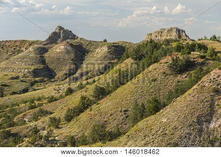 A scenic badlands landscape during the summer.