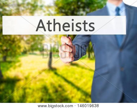 Atheists - Businessman Hand Holding Sign