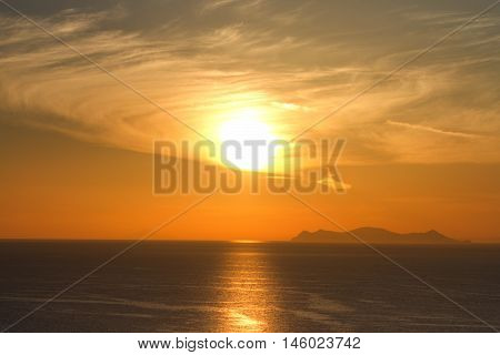 Sunset in Oia Santorini. Volcano caldera on background. Horizontal shot