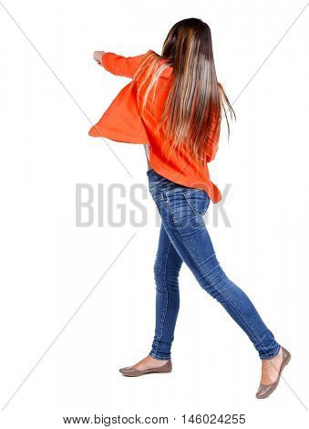back view of woman funny fights waving his arms and legs. girl in a red jacket hand strikes.