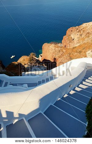 Street view and stairs in Oia Santorini. The sea and caldera on background.