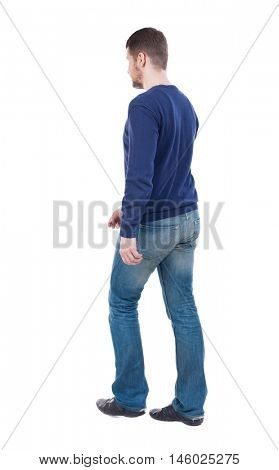 Back view of going  handsome man. walking young guy . Rear view people collection.  backside view of person.  Isolated over white background. The guy in the demi-season jacket leaves. The guy in jeans